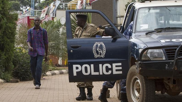 Ugandan police stand guard outside a popular shopping mall in the capital Kampala on September 14, 2014.