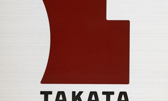 A Logo of Takata Corp. is seen outside the company's headquarters in Tokyo.