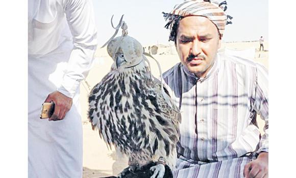Abdullah bin Faraj Al-Qahtani with the rare falcon.