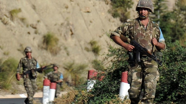 Algerian troops conduct a search operation on October 10, 2014.