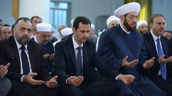State media and Assad's official Twitter feed posted photos of the embattled president praying alongside the country's top Sunni cleric.