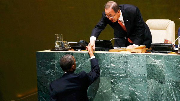 Barack Obama (L) is greeted by Ban Ki-moon before addressing the 69th United Nations General Assembly, September 24, 2014.