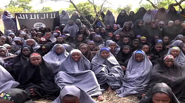 Screengrab taken on May 12, 2014, from a video of Boko Haram obtained by AFP shows girls, wearing the full-length hijab and praying in an undisclosed rural location.
