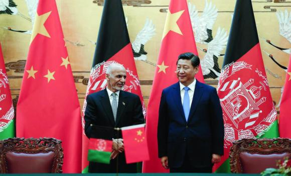 Chinese President Xi Jinping, right, and Afghan President Ashraf Ghani attend a signing ceremony in Beijing on Tuesday.