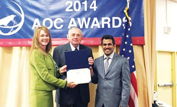 President of the local AOC branch Dr. Sultan bin Khaled Al-Moughi, right, receiving the award at a ceremony in Washington recently.