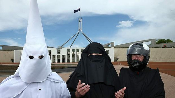 Three men, one dressed in a KKK outfit, tried to enter Australian parliament in protest of the niqab.