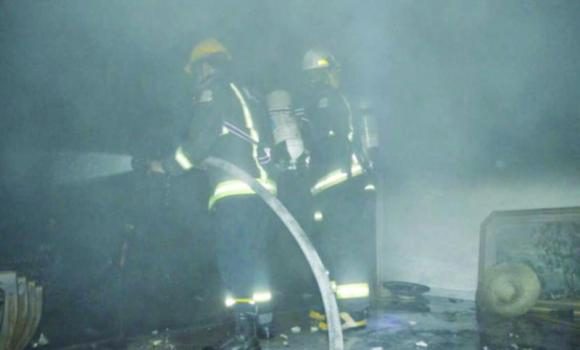 The civil defense teams battling to douse the fire at a house in Safa district in Jeddah on Friday evening.