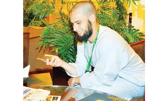 Frenchman Hamza, previously Alexander, sitting in his hotel lobby in Makkah. (SPA)