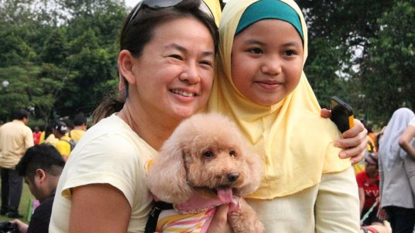 """I want to touch a dog"" was held in a park on the outskirts of the capital Kuala Lumpur Sunday."