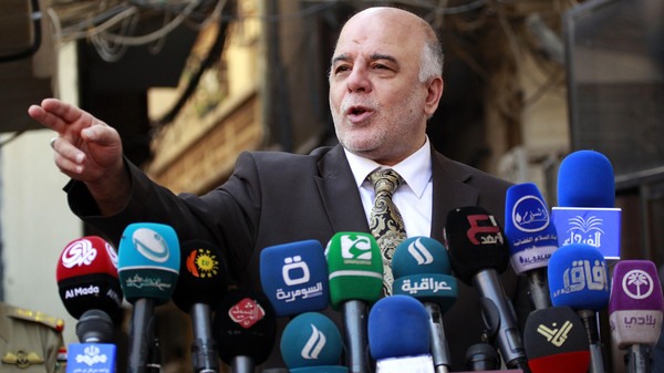 Iraqi Prime Minister Haider al-Abadi gives a press conference on October 20, 2014 in the Iraqi central shrine city of Najaf.