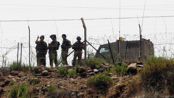 Israeli soldiers patrol the Lebanon-Israel border as seen from a southern Lebanese village.