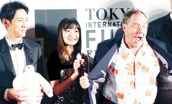 John Lasetter, right, chief creative officer at Pixar, Walt Disney Animation Studios and Disney Toon Studios, poses with Japanese actors during the Tokyo Film Festival.