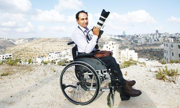 Palestinian war photographer Osama Silwadi has now found success documenting his people's heritage.