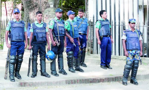 Police officers stand guard in Dhaka, Bangladesh.