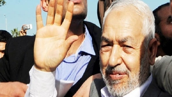 A file photo taken on Jan 30, 2011, shows Rached Ghannouchi, the leader of Tunisia's Islamist movement Ennahdha waving upon his arrival at the Tunis-Carthage airport after 22 years in exile in Britain.