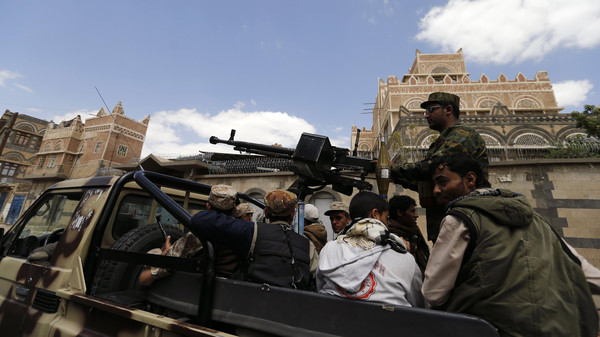 Shiite Houthi militants patrol the vicinity of a venue where a mass funeral for victims of a suicide attack on followers of the Shi'ite Houthi group was being held in Sanaa October 14, 2014.