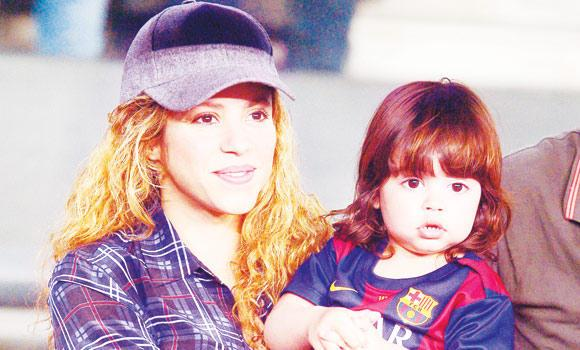 Singer Shakira holds her son prior to a soccer match in Barcelona, in this file photo.