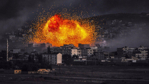 Smoke and flames rise following an explosion in the Syrian town of Kobane, also known as Ain al-Arab, as seen from the southeastern Turkish village of Mursitpinar in the Sanliurfa province on October 20, 2014.