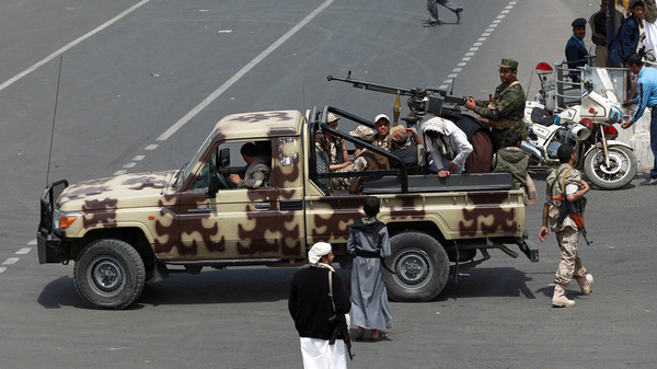 Supporters of the Yemeni Shiite Houthi movement guard a funeral procession, for members of the movement killed in a suicide bombing last week.
