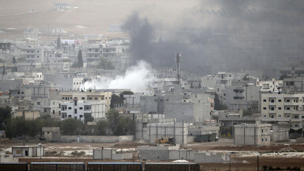 Smoke rises from the Syrian town of Kobane, as seen from the southeastern town of Suruc in Sanliurfa province October 11, 2014.