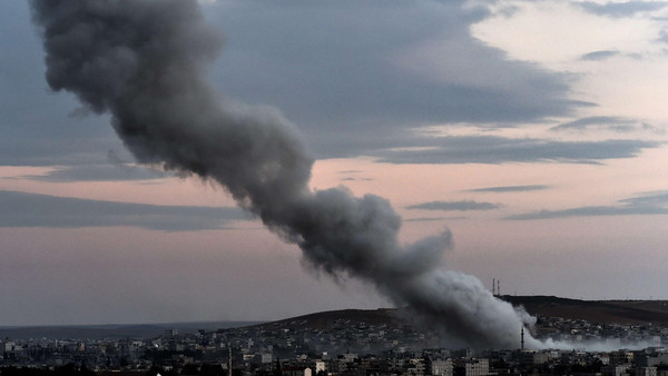 Smoke rises from an explosion in the Syrian town of Kobane, as seen from the Turkish border on October 18, 2014.