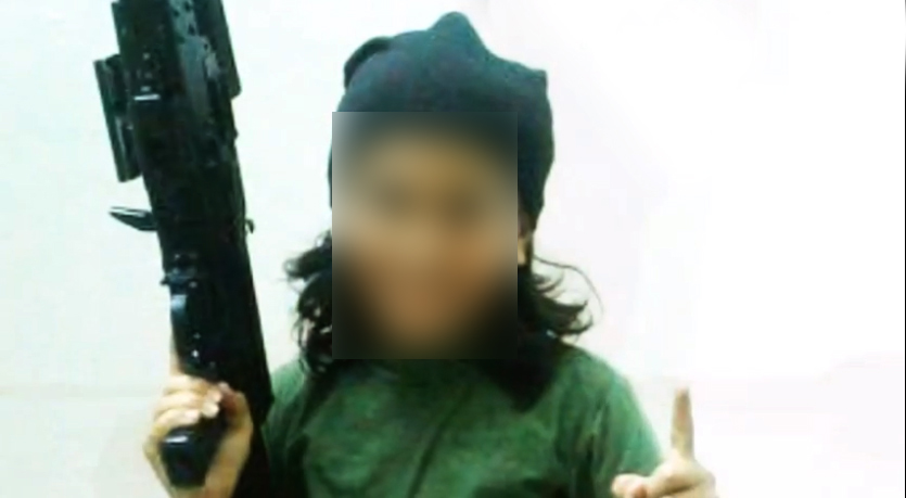 'The Cub of Baghdadi Channel' is seen carrying arms.