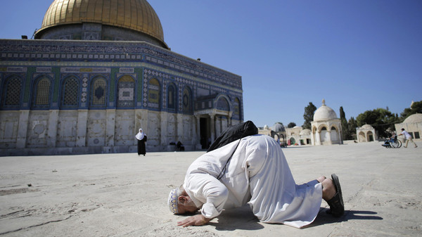 A Palestinian from Gaza prays in front of the Dome of the Rock during their visit at the compound known to Muslims as Noble Sanctuary and to Jews as Temple Mount in Jerusalem's Old City.