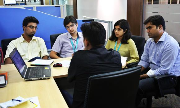 A woman employee attends a meeting with her male colleagues at Titan Company's corporate office in Bangalore, India, on Tuesday.