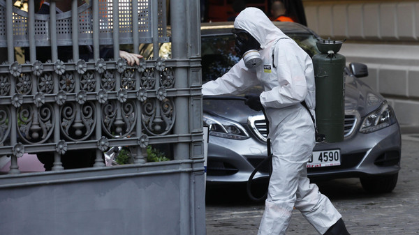A member of the Turkey's disaster management agency (AFAD) disinfects the garden of German Consulate in Istanbul October 24, 2014.