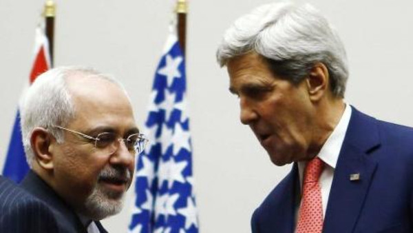 U.S. Secretary of State John Kerry (R) shakes hands with Iranian Foreign Minister Mohammad Javad Zarif after a ceremony at the United Nations in Geneva November 24, 2013.
