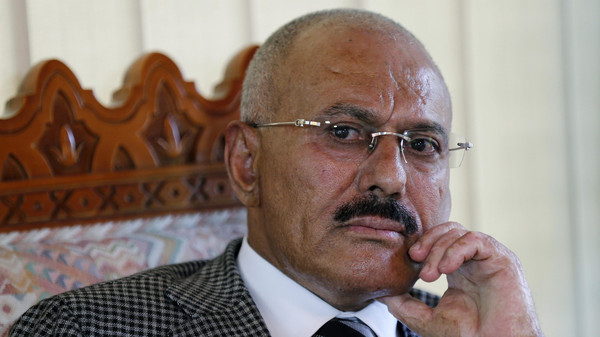 Yemen's former President Ali Abdullah Saleh pauses during an interview with Reuters in Sanaa May 21, 2014.