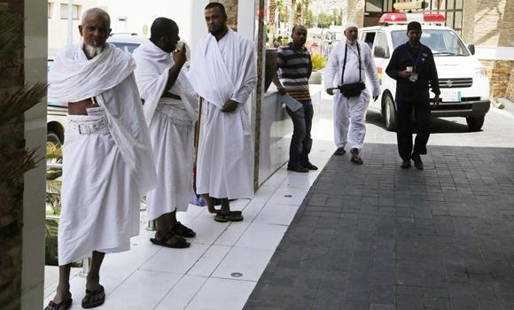 Muslim pilgrims wait in front of the emergency department at Al-Noor Specialist Hospital in Makkah on Sept. 30, 2014. Nearly half a million pilgrims made use of medical facilities that were available in Makkah and Madinah during Haj this year, according to Mansour Al-Hawasi, deputy health minister for health affairs.