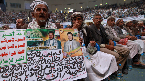 A Yemeni displays a poster bearing the portrait of the Shiite Houthi movement's leader Abdul-Malik al-Huthi during a gathering in the capital Sanaa on Oct. 31, 2014.