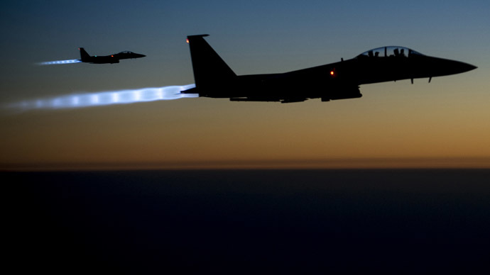 A pair of U.S. Air Force F-15E Strike Eagles fly over northern Iraq after conducting airstrikes in Syria, in this U.S. Air Force handout photo.