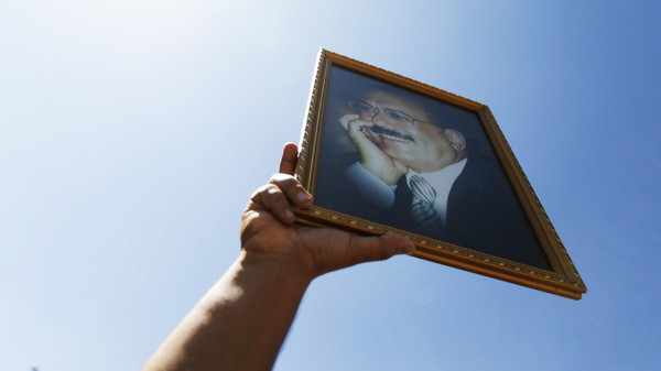A supporter of Yemen's former President Ali Abdullah Saleh holds up a poster of Saleh during a rally in his support in Sanaa November 7, 2014.