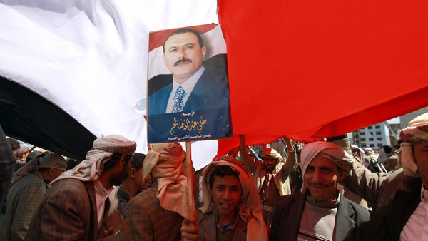 A young supporter of Yemen's former president Ali Abdullah Saleh holds a portrait of him during a rally on Nov. 7, 2014 in Tahrir Square in the capital Sanaa.