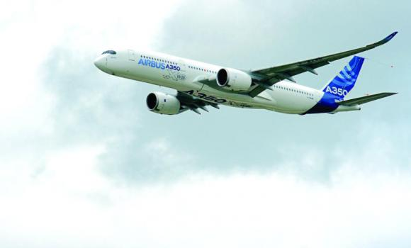 An Airbus A 350 flying over Le Bourget airport near Paris during the 50th International Paris Air show.