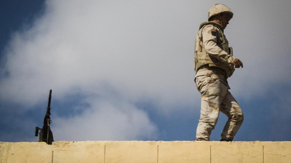 An Egyptian soldier stands guard along the Rafah border with Israel on July 19, 2014.