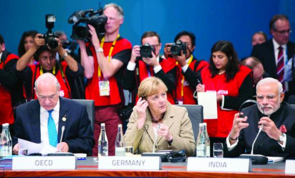 OECD Secretary-General Angel Gurria, Germany's Chancellor Angela Merkel and India's Premier Narendra Modi at the G-20 Leaders' Summit in Brisbane.