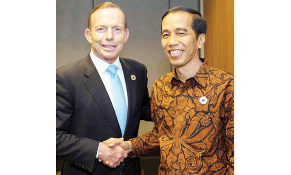 Australia's Prime Minister Tony Abbott meets with Indonesia's President Joko Widodo before the start of the G-20 summit in Brisbane.