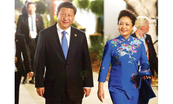 Chinese President Xi Jinping and his wife Peng Liyuan arrive at The Queensland Gallery of Modern Art for an official function during the G-20 summit in Brisbane.