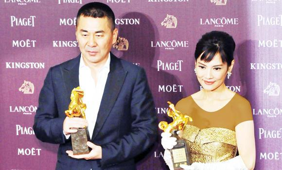 Chinese director and actor Chen Jianbin holds his trophy after winning Best Leading Actor next to Taiwanese actress Chen Shiang-chyi who won Best Leading Actress at the 51th Golden Horse Film Awards in Taipei.