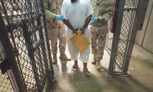 File photo showing US military guards as they move a detainee inside Camp VI at Guantanamo Bay, Cuba.
