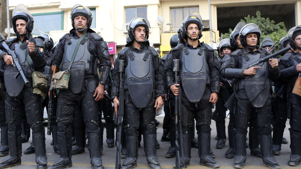 Riot police take their positions in Tahrir Square as protesters and activists called for demonstrations on the third anniversary of the Mohamed Mahmoud violent clashes in central Cairo.
