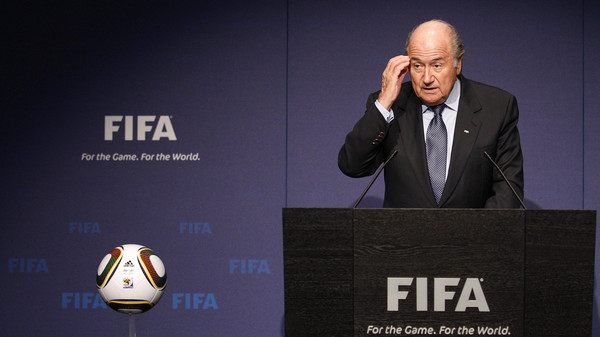 FIFA filed a criminal complaint against unnamed individuals on Tuesday over the 2018 and 2022 World Cup bidding contests won by Russia and Qatar.