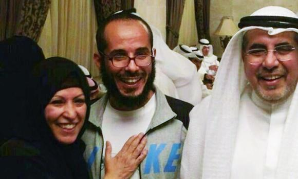 A handout picture released by the family shows Fawzi al-Odah (C), one of two Kuwaiti detainees remaining at Guantanamo, posing with his father and a relative as he welcomed at a military hospital in Kuwait City upon his arrival in the Gulf state on November 6, 2014 after 13 years in prison.