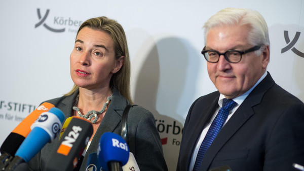 "EU foreign policy chief Federica Mogherini (L) and German Foreign Minister Frank-Walter Steinmeier answer journalists' questions during the opening of the ""Berlin Forum Foreign Policy"" on Nov. 11, 2014 in Berlin."