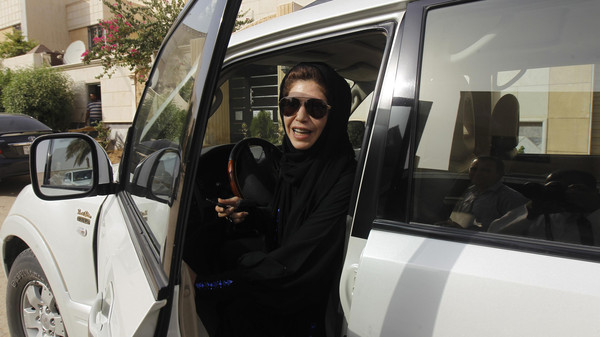 Female driver Azza al-Shmasani alights from her car after driving in defiance of the ban in Riyadh June 22, 2011.