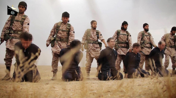 An image grab taken from a propaganda video released on November 16, 2014 allegedly shows ISIS militants preparing the simultaneous beheadings of at least 15 men described as Syrian military personnel.