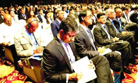 Delegates attend the opening plenary of the India Economic Summit in New Delhi.